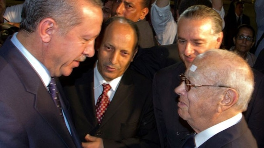 Sept. 14: Tunisian Prime Minister Beji Caid Essebsi, right, greets his Turkish counterpart Recep Tayyip Erdogan , left, at the Tunis-Carthage airport, Tunisia.