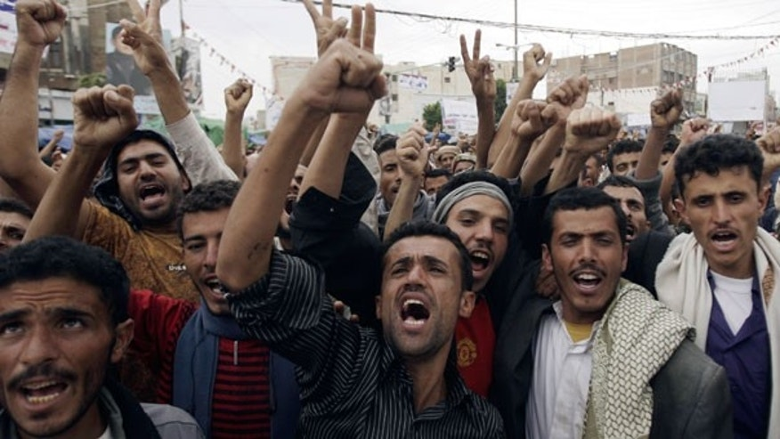 Sept. 14: Yemeni protestors chant slogans during a demonstration demanding the resignation of Yemeni president Ali Abdullah Saleh in Sanaa, Yemen.