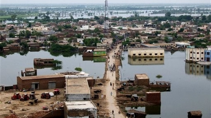 September 16: Floodwaters are seen in Badin district, near Hyderabad, Pakistan. Floods caused by heavy rains have killed more than 200 people, made about 200,000 people homeless and left 4.2 million acres of agriculture land inundated with water, authorities said.