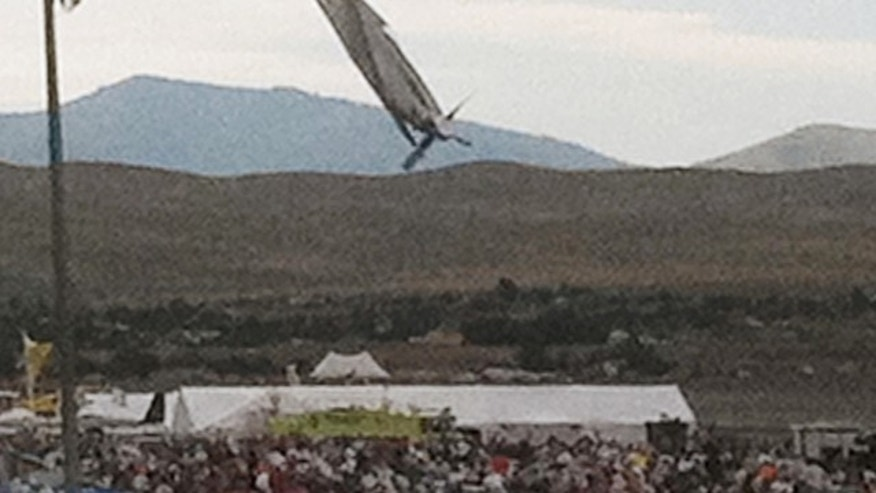 In this Friday, Sept. 16, 2011 photo, a P-51 Mustang airplane approaches the ground right before crashing during an air show in Reno, Nev. The vintage World War II-era fighter plane piloted by Jimmy Leeward plunged into the grandstands during the popular annual air show. (AP Photo/Garret Woodson)