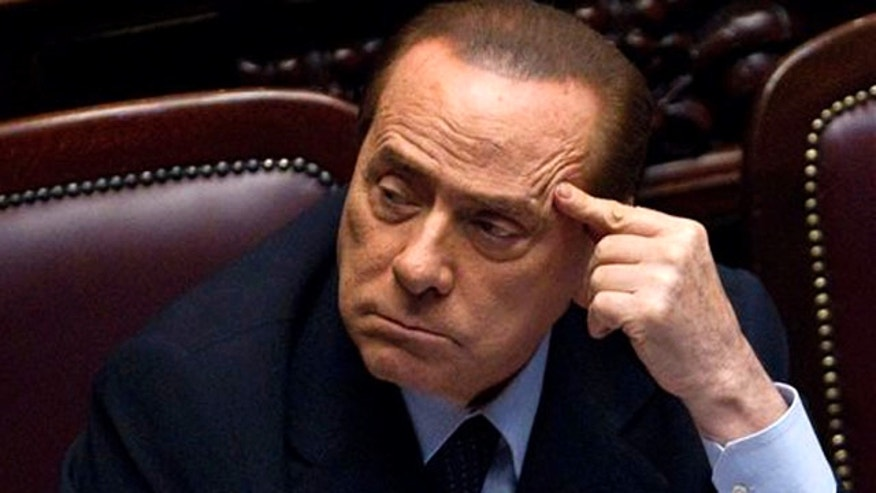 Italian Premier Silvio Berlusconi votes over a crucial austerity package.