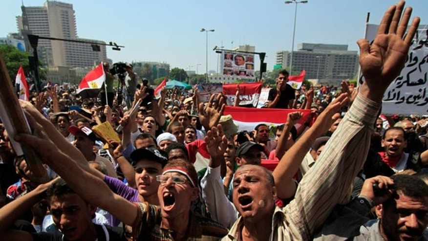 Sept. 16: Demonstrators chant slogans as they protest in Tahrir Square, Cairo, Egypt.