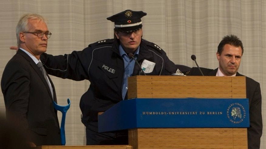Sept. 19: A police officer calls for an immediate evacuation of the main hall of the Humboldt University minutes prior to a speech of Turkish President Abdullah Gul in Berlin.
