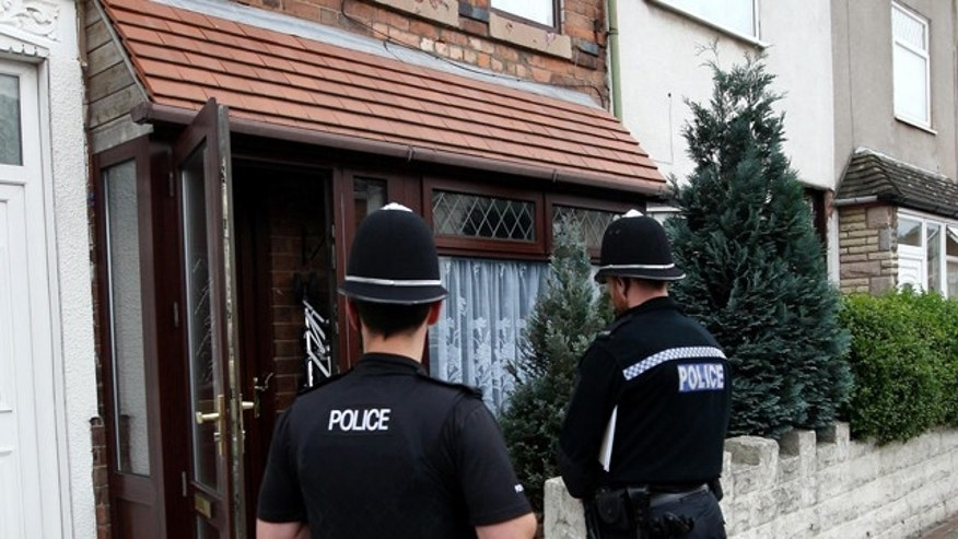 Sept. 19: Police guard a house in Asquith Rd, Ward End, Birmingham, England following the arrest of six men in Birmingham as part of a large intelligence-led counter-terrorism operation.