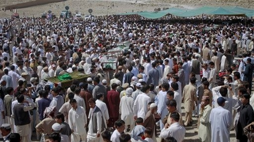 September 21: Mourners carry caskets of the victims of Tuesday's shooting incident for their funeral prayer in Quetta, Pakistan.