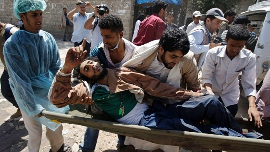 Sept. 20: Yemeni anti-government protestors carry an injured protestor from the site of clashes with security forces in Sanaa.