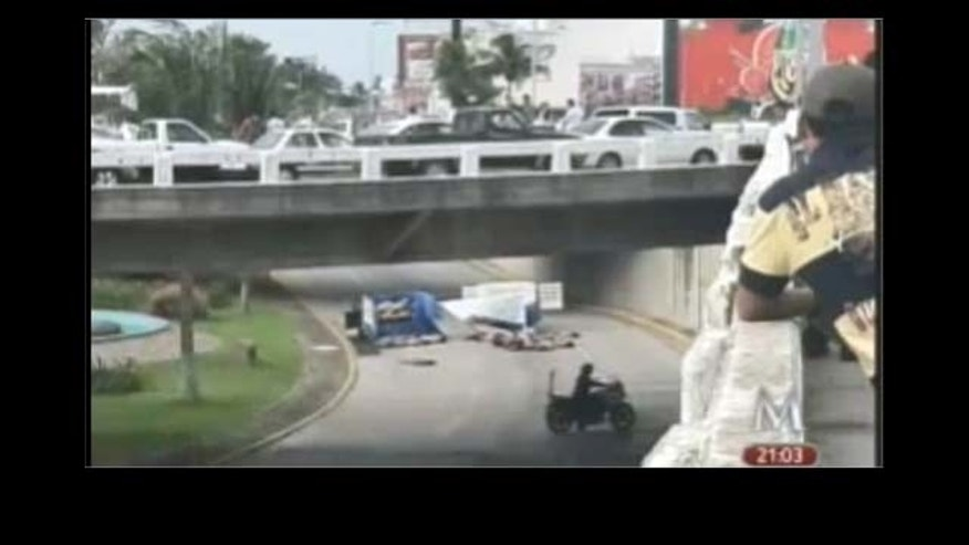 Sep. 20: A screenshot from Milenio TV in Mexico of the 35 bodies dumped in the middle of traffic in a busy road in the downtown of Boca del Rio.