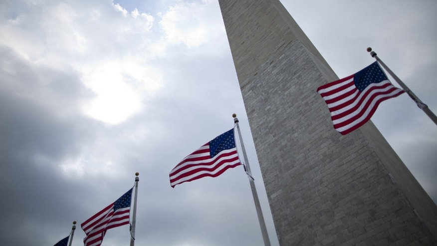 WASHINGTON, DC - MAY 2:  Flags fly at the base of the Washington Monument May 2, 2011 in Washington, DC. The DC area and other places around the nation have stepped up security after it was announced that Osama bin Laden, mastermind of the September 11th terror attacks, was killed in a firefight with United States forces in Pakistan.  (Photo by Brendan Smialowski/Getty Images)