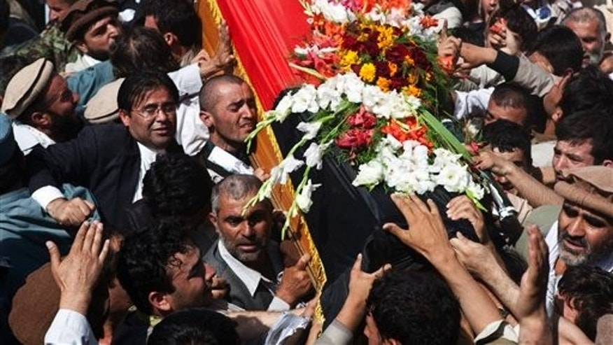 September 23: Afghans carry the coffin of Burhanuddin Rabbani, former Afghan president during his burial ceremony on Wazir Akbar Khan hill in Kabul, Afghanistan.