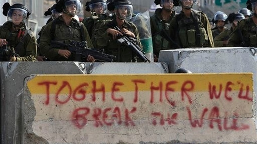 September 23: Israeli forces stand by during clashes with Palestinians at Qalandia checkpoint between Jerusalem and Ramallah.