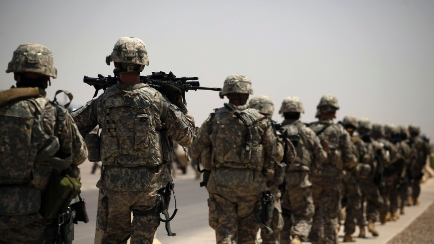 Aug. 2, 2011: U.S. Army soldiers make their way to a C-130 aircraft at Sather Air Base in Baghdad, Iraq to begin their journey home to the United States.