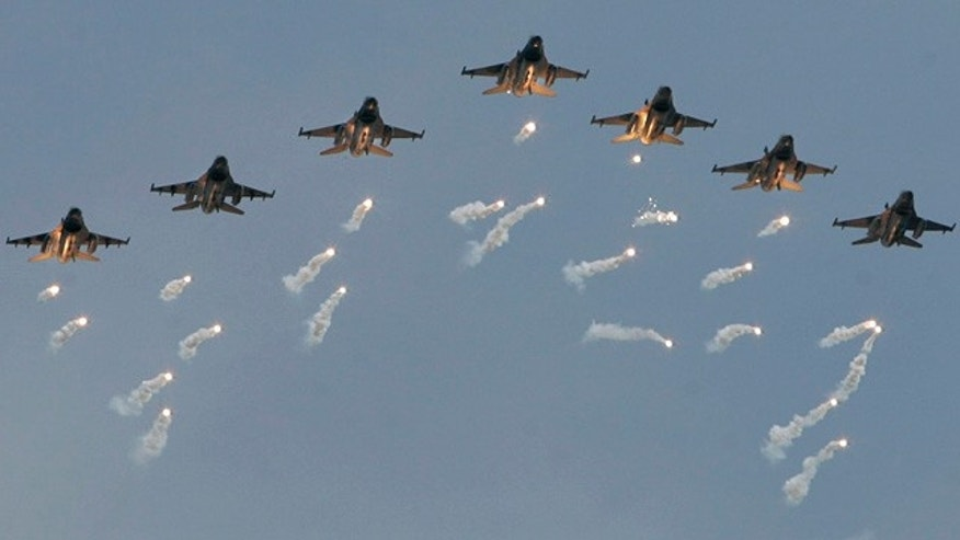 FILE 2007: Taiwanese air force F-16 fighter jets fly in formation as they drop anti-missile deterrents during military exercises.