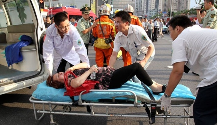 Sept. 27: Rescuers carry the injured after two subway trains collided in Shanghai, east China.
