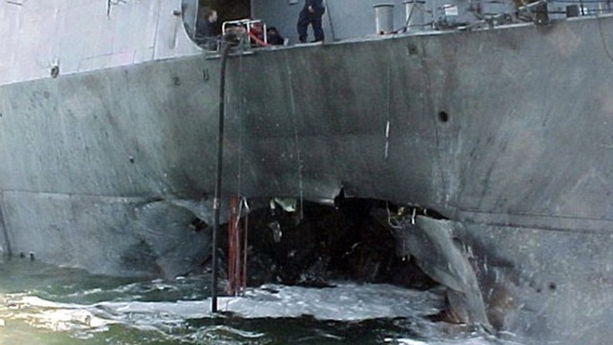 FILE 2000: The port side damage to the guided missile destroyer USS Cole is pictured after a bomb attack during a refueling operation in the port of Aden.