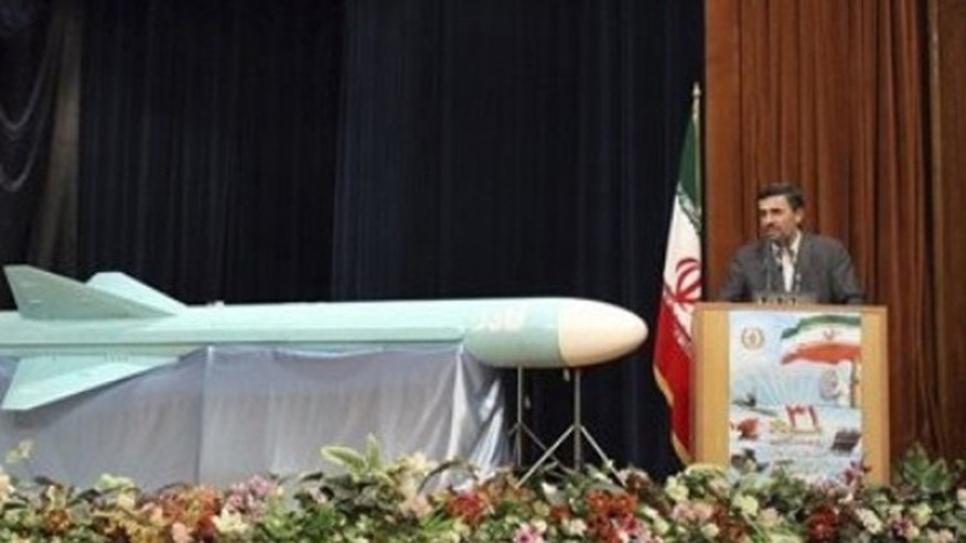 Aug. 23: President Mahmoud Ahmadinejad stands next to a Ghader, or Capable, a new Iranian-made cruise missile, in Iran.