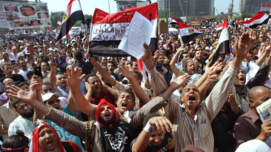 Several thousand Egyptians protesters shout against the country's military rulers decision to retain the much hated emergency laws used throughout the reign of ousted President Hosni Mubarak to give police almost unquestionable powers to operate at Tahrir Square, the focal point of Egyptian uprising, in Cairo, Egypt, Friday, Sept.30, 2011.