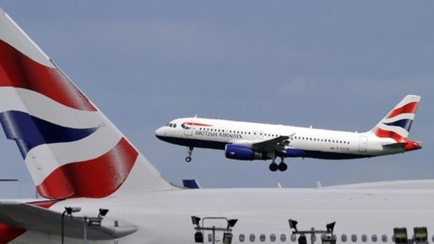 A British Airways plane flies into Heathrow Airport in west London.