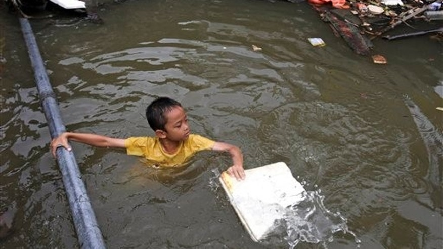 October 3: A Thai boy in a flooded area in Bangkok. Hundreds of people have died across Southeast Asia, China, Japan and South Asia in the last four months from prolonged monsoon flooding, typhoons and storms. The Thailand government said heavy floods have killed over 200 people since August.