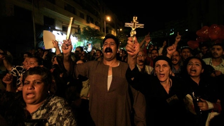 Oct. 4, 2011: Egyptian Copts hold Christian crosses and chant slogans as they demonstrate against the sectarian violence, in downtown Cairo, Egypt. In the past few weeks, riots have broken out at two churches in southern Egypt, prompted by Muslim crowds angered by rumors that Christians were building new churches.