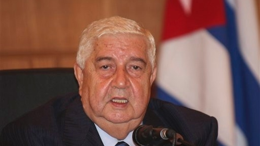 "Oct. 9: Syrian Foreign Minister Walid al-Moallem, speaks during a join press conference with his Venezuelan and Cuban counterpats Nicolas Maduro and Bruno Rodriguez Parrilla, not seen, in Damascus, Syria. Syria's foreign minister has warned the international community not to recognize a new council formed by the opposition, saying it is ""illegitimate."" Walid al-Moallem has warned that Damascus will take measures against any country that recognizes the Syrian National Council. He did not elaborate."