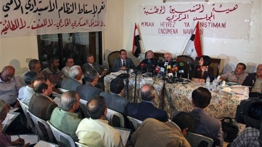 Oct. 6: Syrian opposition members attend a Syrian opposition meeting in the Halboun area, near the capital Damascus, Syria. Some 75 opposition figures held a rare public meeting in which they called for the downfall of the regime.