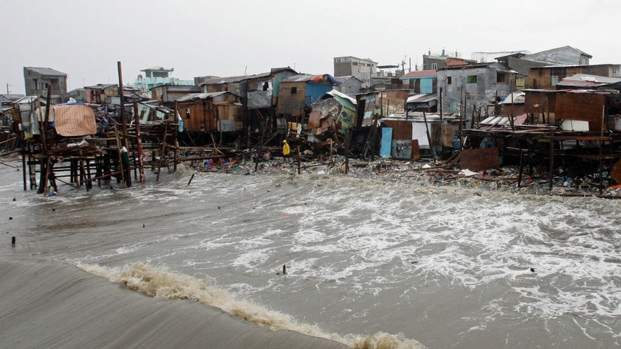Shanties built along the shore were destroyed by big waves during the height of typhoon Nesat as rains pour due to Typhoon Nalgae Saturday, Oct. 1, 2011 in Navotas town north of Manila, Philippines.