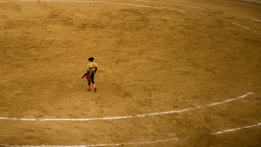 A bullfighter in Spain. Barcelona may have banned bullfighting but Mexico-style bullfighting in New Jersey goes on. Rigoberto Flores, 24, lost his life and is being mourned by the community and fans.
