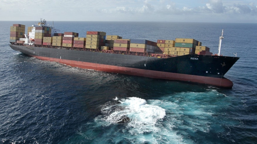 The container ship Rena sits stranded on a reef off the coast of Tauranga, New Zealand, Wednesday, Oct. 5, 2011.