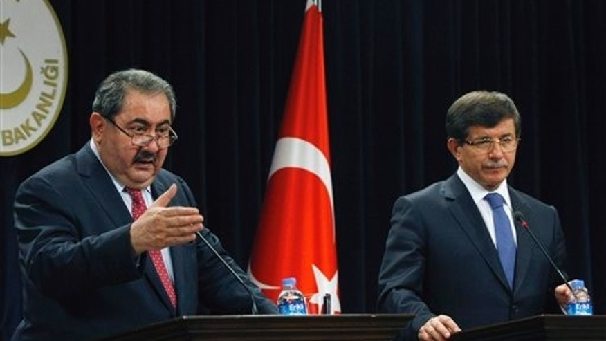 October 13: Iraqi Foreign Minister Hoshyar Zebari, left, and his Turkish counterpart Ahmet Davutoglu speak to the media after their talks in Ankara, Turkey.
