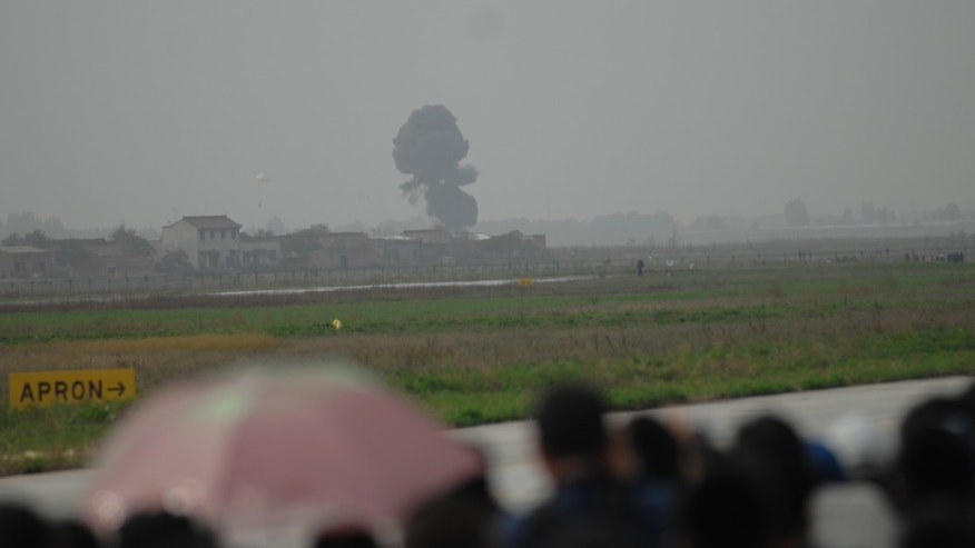 Dense smoke is seen after an aircraft crash during an air show in Pucheng county, northwest China's Shaanxi Province Friday, Oct. 14, 2011.
