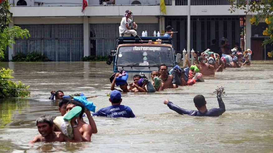 Prisoners at Ayutthaya prison wade in line in a chest-deep flood water to board a bus during an evacuation after flood water hit Ayutthaya province, central Thailand Thursday, Oct. 6, 2011. Nearly 5,000 prisoners in this province were evacuated to the prisons in nearby provinces of Nonthaburi and Lopburi. Flooding in Ayutthaya, the old Thai capital, could threaten ancient Buddhist temples and have alerted residents there to be ready to evacuate as a tropical storm approaches the region.