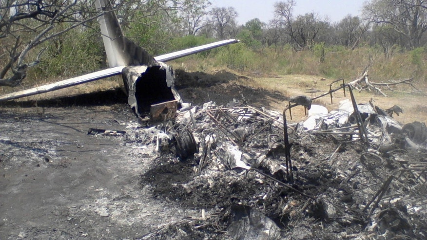 Oct. 15, 2011:Tthe wreck of a crashed plane lays in the bush in the Okavango Delta. The light aircraft carrying 12 people crashed shortly after takeoff killing the British pilot and seven tourists from France, Switzerland and Britain, an official and rescue workers said.
