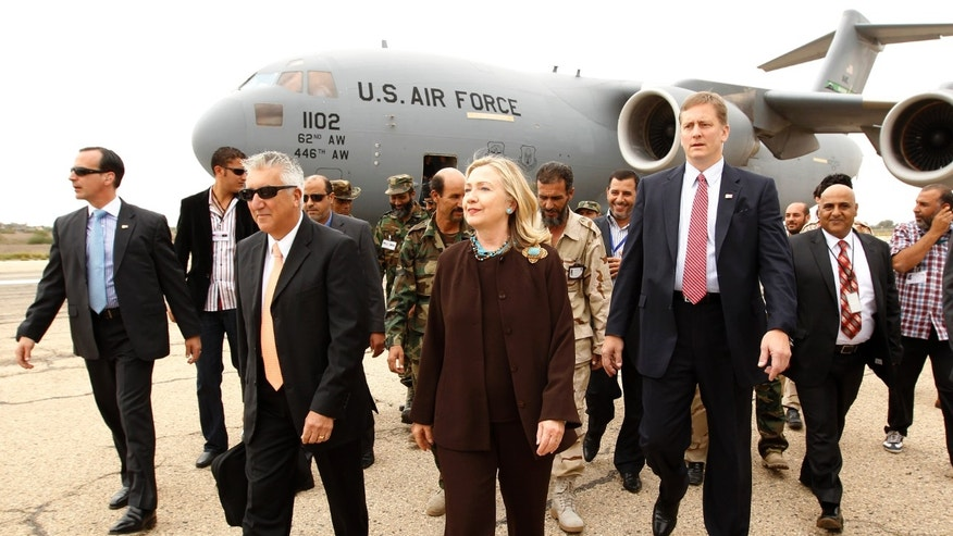 October 18: U.S. Secretary of State Hillary Rodham Clinton walks from  her C-17 military transport upon her arrival in Tripoli  Libya.
