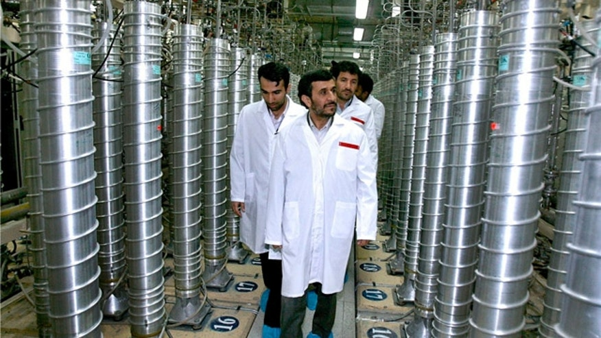 FILE - Iranian President Mahmoud Ahmadinejad visits the Natanz Uranium Enrichment Facility some 200 miles south of the capital Tehran, Iran.