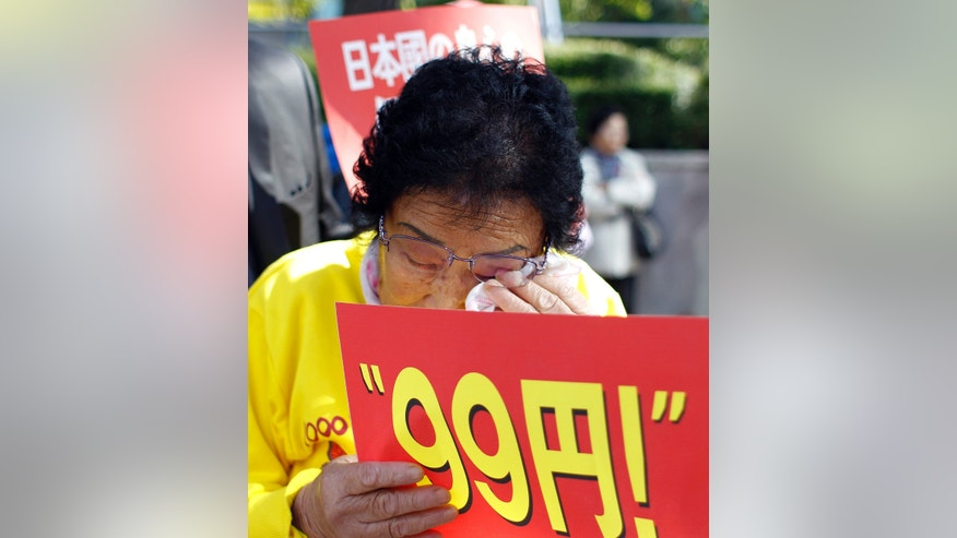Oct. 18, 2011: 83-year-old Yang Keum-duk, who said was forced to work in Japan during the 1910-45 colonization of the Korean Peninsula, wipes her tear during a rally ahead of Japanese Prime Minister Yoshihiko Noda's visit in front of the Japanese Embassy in Seoul, South Korea.