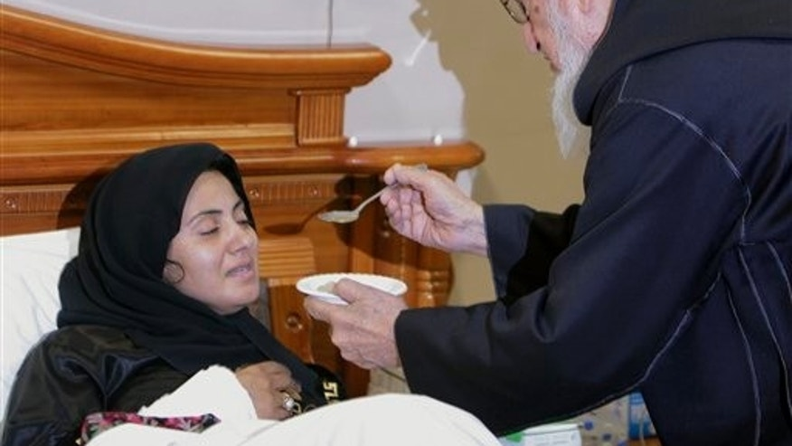 October 19: Former Afghan President Subghatullah Mujaddedi feeds ousted lawmaker Simeen Barakzai and she breaks her hunger strike after 18 days in Kabul, Afghanistan.