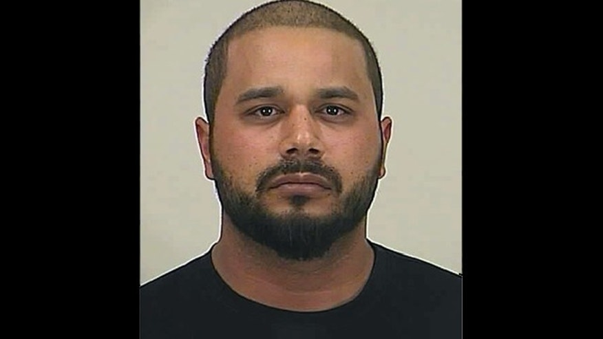 This photo provided by the Pinal County Sheriff's Office shows Jason Alistair Lowery. Lowery, a deportation officer with U.S. Immigration and Customs Enforcement, is accused of leading police on a high-speed chase in the Arizona desert while dumping bales of marijuana out of his government vehicle.
