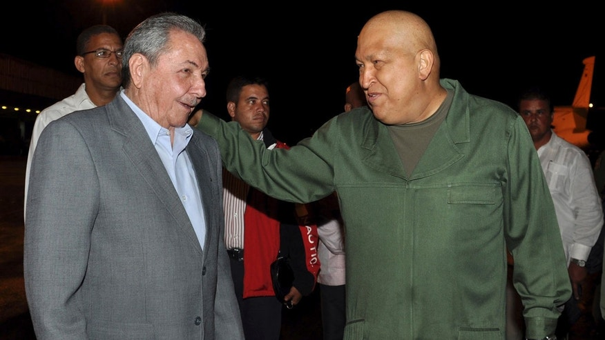 "In this picture released by Cuba's state newspaper Granma and taken by Estudios Revolucion, Cuba's President Raul Castro, left, greets Venezuela's President Hugo Chavez, right, upon his arrival at the Jose Marti international airport in Havana, Cuba, late Sunday Oct. 16, 2011. Chavez returned to Cuba on Sunday to undergo a series of medical tests to evaluate his cancer treatment. Chavez, who finished what he described as his fourth and final round of chemotherapy in Cuba last month, said he will be undergoing what he described as ""rigorous examinations."" (AP Photo/Estudios Revolucion)"