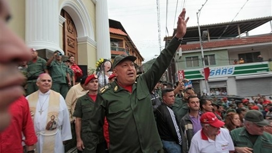 Oct. 20, 2011: Venezuela's President Hugo Chavez greets supporters upon his arrival to La Grita, Venezuela.