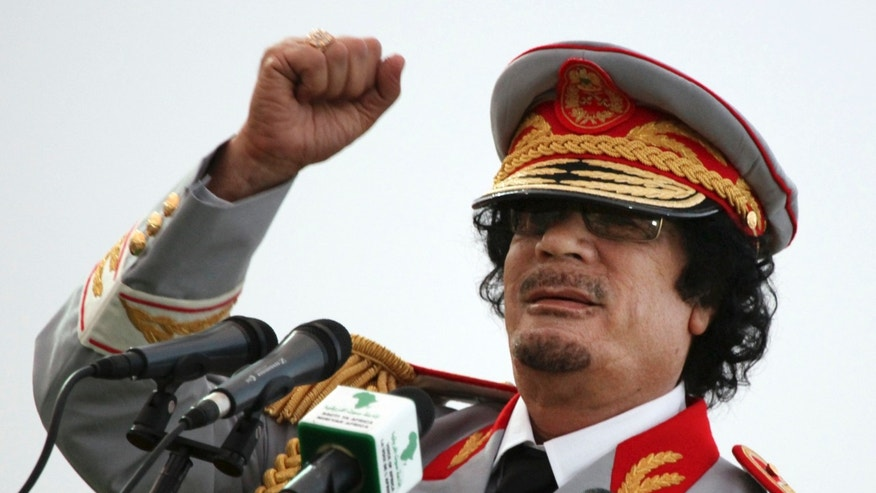 June 12, 2010: Qaddafi talks during a ceremony to mark the 40th anniversary of the evacuation of the American military bases in the country, in Tripoli, Libya.