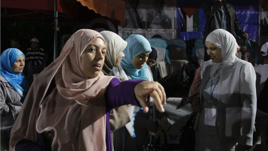 Oct. 20, 2011: Islamic Ennahda party supporters, wearing the traditional islamic headscarf, are seen during a rally in Le Kram, near Tunis, Tunisia.