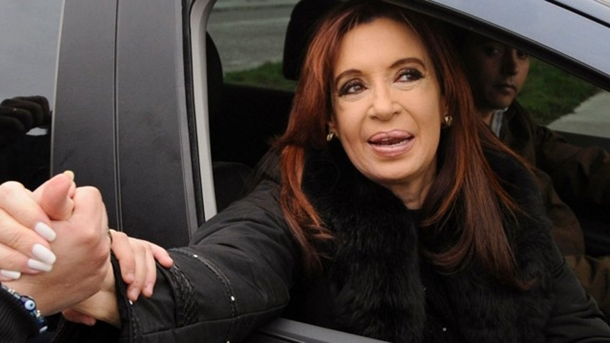 Oct. 23: Argentina's President Cristina Fernandez greets supporters after voting in the general elections in Rio Gallegos, Argentina.