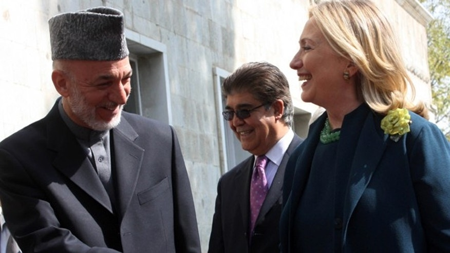 Oct. 20: US Secretary of State Hillary Rodham Clinton, right, shakes hands with Afghanistan's President Hamid Karzai during their meeting in Kabul.