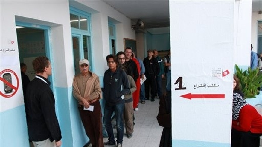 Oct. 21: Tunisians voters stand in a line outside the poling station in Menzeh near Tunis. Tunisians began voting Sunday in their first truly free elections, the culmination of a popular uprising that ended decades of authoritarian rule and set off similar rebellions across the Middle East.