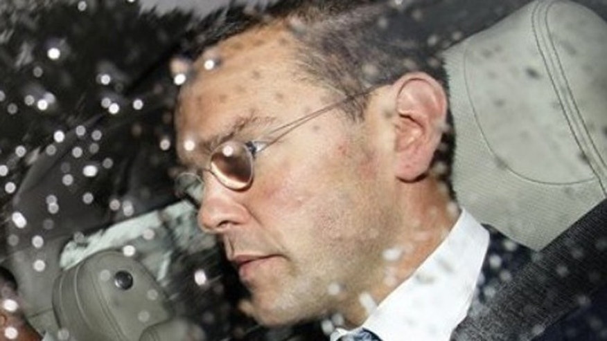 July 19, 2011: James Murdoch leaves parliament after giving evidence to the Culture, Media and Sport Select Committee on the News of the World phone-hacking scandal in London.