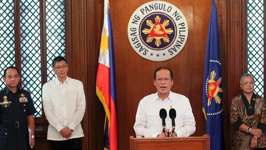 Oct. 24, 2011: In this photo released by Malacanang Palace, Philippine President Benigno Aquino III addresses the media during a news conference at the Presidential Palace in Manila, Philippines. Aquino announced the Philippine military has launched air strikes against suspected outlaws in a southern town, but the country's largest Muslim rebel group said its followers are being affected by the bombings.