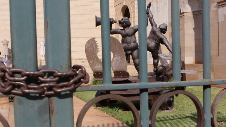 "Oct. 11, 2011: A metal sculpture titled: ""Tightroping"" by sculptor David Brown is seen locked behind bars at the Johannesburg Art Gallery."