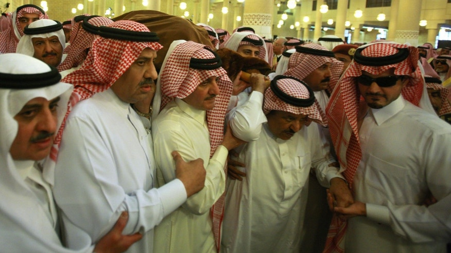 Oct. 25, 2011: Saudi Interior Minister Prince Nayef bin Abdul-Aziz Al Saud, second right, carries with Saudi Deputy Defense Minister Prince Khaled bin Sultan, second left, and other princes the shrouded body of late Crown Prince Sultan bin Abdul-Aziz Al Saud before performing special prayers at the Imam Turki bin Abdullah mosque in Riyadh, Saudi Arabia.