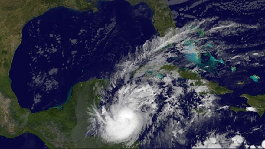 This image provided by NASA show Hurrican Rina, bottom center, acquired at 12:31 a.m. EDT Wednesday Oct. 26, 2011. Rina's maximum sustained winds remained steady at about 110 mph (175 kph), according to the U.S. National Hurricane Center in Miami, making it a Category 2 storm. Forecasters predict it will strengthen as it nears the Mexican coast Wednesday night before rolling over the island of Cozumel, a popular dive spot and cruise-ship port, then along the coast to Cancun. (AP Photo/NASA)
