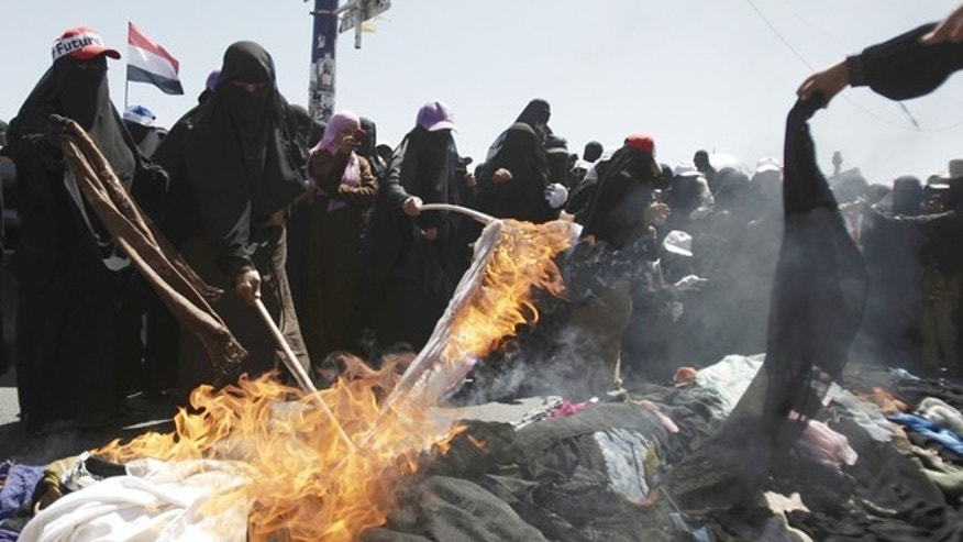 Oct. 26, 2011: Protesting Yemeni women burn their veils during a demonstration demanding the resignation of Yemeni President Ali Abdullah Saleh in Sanaa, Yemen.